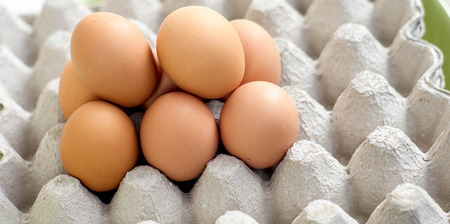 Eggs are laid on the paper tray for background Stock Photo