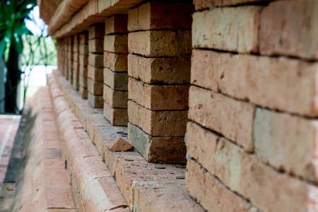 feats: Closed up of Graffiti brick wall in Thailand