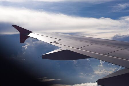 Aircraft Wing  view from the cabin and cloud and blue sky Stock Photo