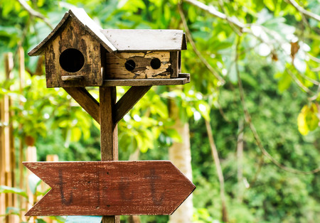 Wooden sign with space to write,The top of the nest is made of old wood. Stock Photo