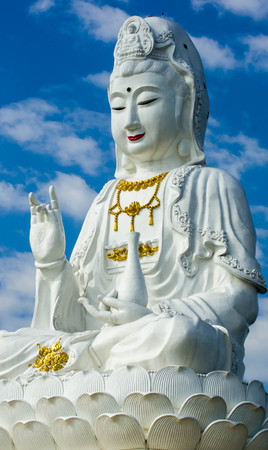 Guanyin buddha stutue with blue sky background ,god of buddhism