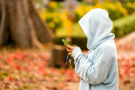 woman wearing modern coat, check smartphone.