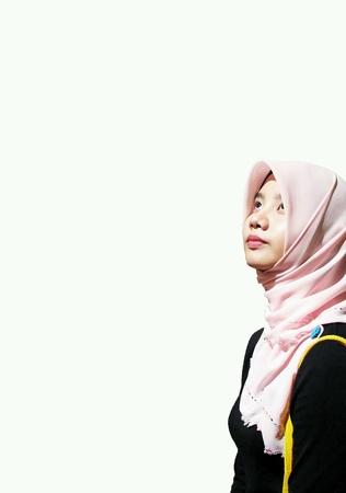 up: Beautiful muslim girl looking up