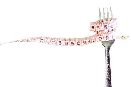 Gabel mit Maß Hahn für Diät-Konzept isoliert