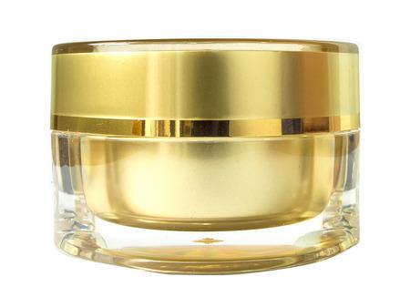 Luxury gold cream bottle isolated