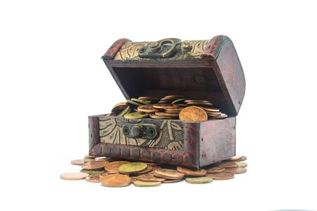 hoard: Old wooden chest with golden coins isolated on the white background