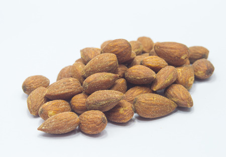 salted and roasted almonds on white background Stock Photo