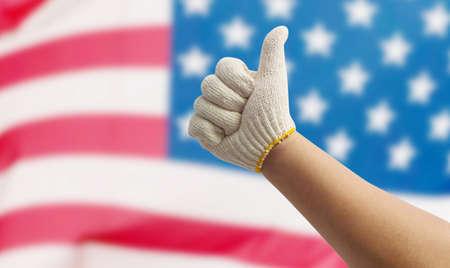 jornada de trabajo: Mano de obra en el fondo de la bandera de EE.UU. Foto de archivo
