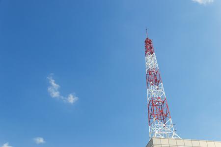 transmit: Telecommunication tower on blue sky blank background. Used to transmit television and telephony signal