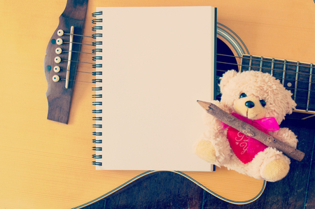 bear doll: cut bear doll with guitar on the wooden background Stock Photo