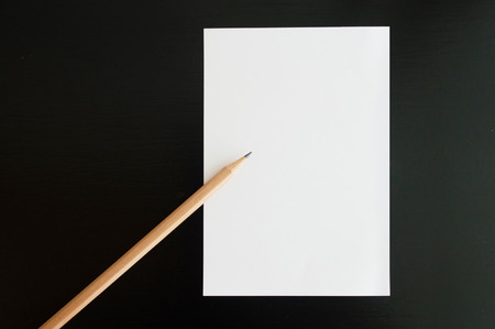 postit note: Blank  post-it note with pencil on the table Stock Photo