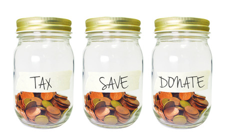 tax tips: coins in bottle with Tax Saving Donate plan label on white background,financial concept