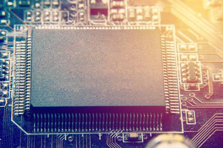 primer plano de la placa de circuito electrónico con imagen de efecto retro de fondo de procesador Foto de archivo