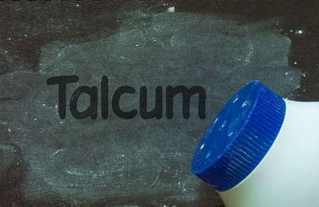 talcum: Talcum powder and write word talcum on black grunge background
