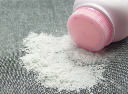 Baby talcum powder container on gray fabric background 写真素材
