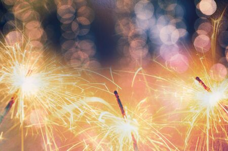 sparkler with bokeh de focused blurred background,New year celebration background Stock Photo