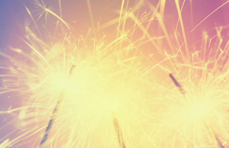 sparkler de focused blurred background retro effect image Stock Photo