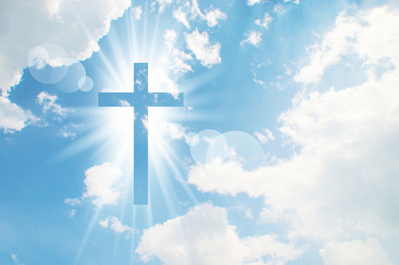 bright sky: Christian cross appears bright in the sky background