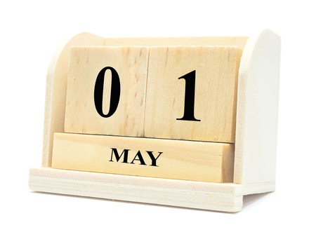 may 1 cube wood calendar International Workers Day,Happy May Day vintage cube calendar on the white background.  Stock Photo
