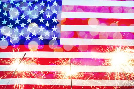 Celebrating Independence Day. United States of America USA flag with sparklers background