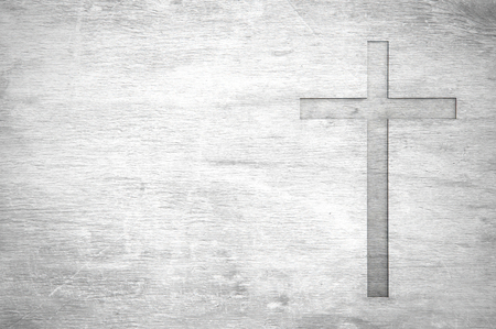 White old christian religion symbol cross shape as sign of belief on a grungy wood textured with copy space. Stock Photo