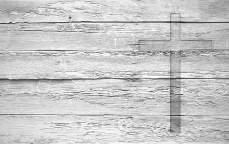 White old christian religion symbol cross shape as sign of belief on a grungy wood textured with copy space. Stock fotó