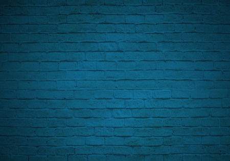 Empty blue brick wall backgroud faded on black Stock Photo