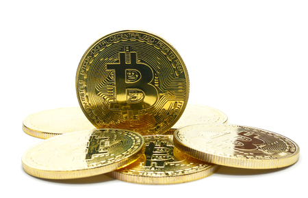 stack of Physical Bitcoins  isolated on the white background Stock Photo
