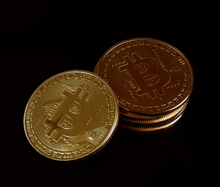 stack of Physical Bitcoins  virtual currency on the black background