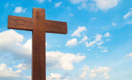 wooden cross on the blue sky cloudy with copyspace Imagens