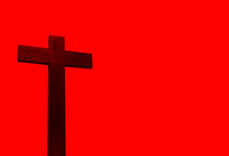 Christian cross isolated on red background,duotone effect. Reklamní fotografie