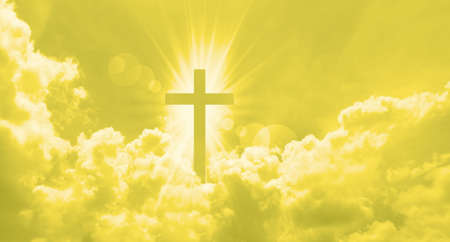 Christian cross appears bright in the yellow sky background