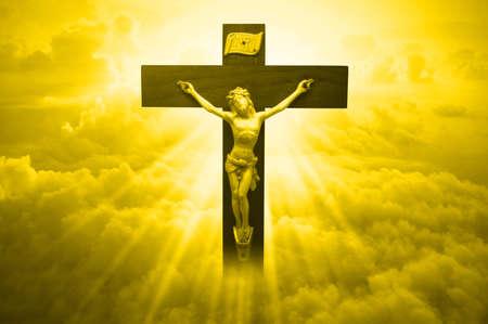 Jesus Christ on sky background with a shining sun lightning Foto de archivo