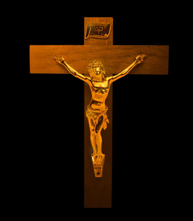 Gold Jesus Christ on the Cross with a Crown of Thorns Jesus of Nazareth King of the Jews Statue on the black background