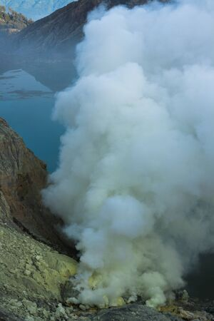 crater: smoke that arise from ijen crater, East java, Indonesia, a place that produce sulphur also a tourist location