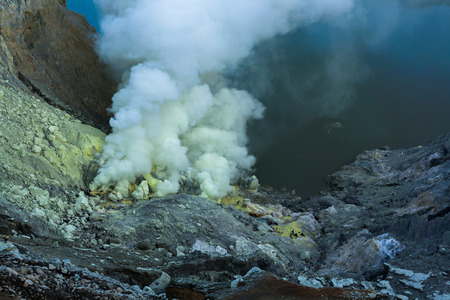 caldera: Ijen crater is a place that produce sulphur and also a tourism place in East java, Indonesia.