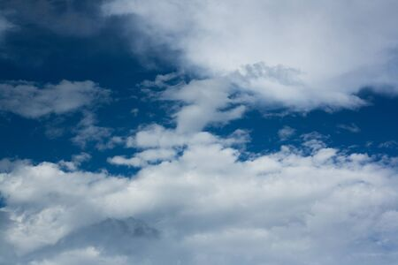 meteorology: Blue sky dominated by white clouds Stock Photo