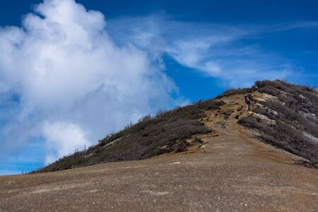 java: Dirt road to top of the hill at Ijen Crater, East java, Indonesia Stock Photo