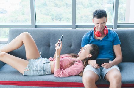 Caucasian husbands and wives are enjoying their hobbies at home. Video communication via high-speed internet While the virus is spreading Everyone must be at home.