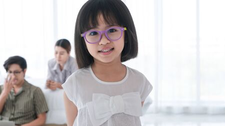 Close-up photos of Asian girls and their families. Parents are playing happily and happily with their little daughter in the bedroom. Being happy to be with family on holidays