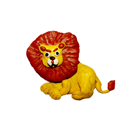 Plasticine  baby lion sculpture isolated on white