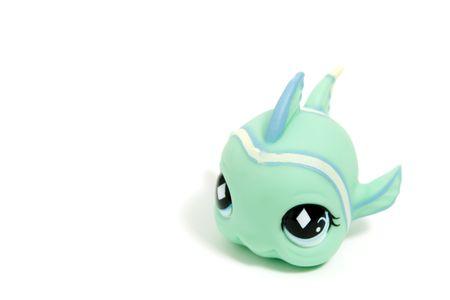 fish toy: cute giocattolo pesce con grandi occhi, isolato su bianco Archivio Fotografico