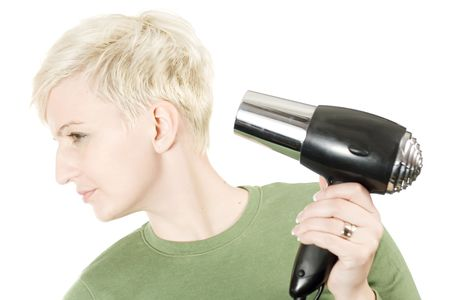короткие волосы: Young woman with hairdryer, isolated on white background.