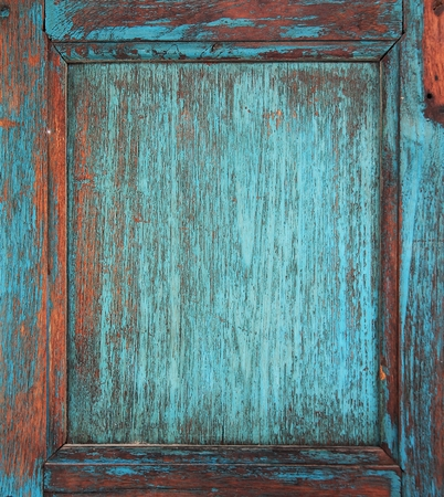 wood surface: Door wood Blue painted  with chapped surface.