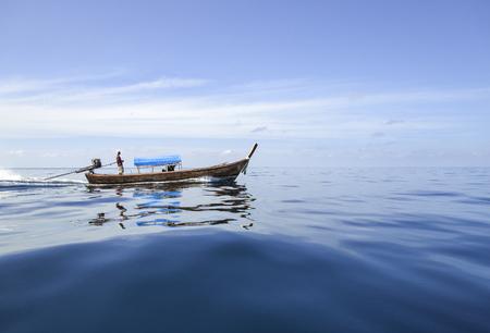 swiftly: Boat go swiftly through the sea