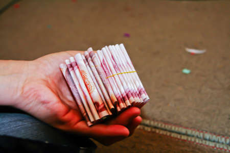 counted: Money is counted and folded in a hand