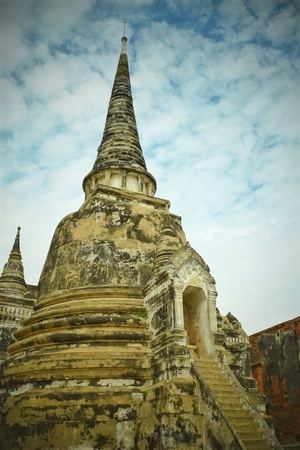 Pagoda an ancient remains with cloudy sky in Ayuthaya historic site, Thailand Stock Photo