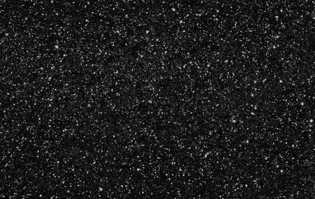 White and gray spot on black background like stars shining on night sky