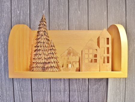 Wooden decoration in Christmas holiday theme on wooden shelf on wooden wall
