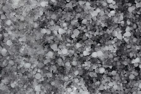 Close up of hail stones layer on the ground
